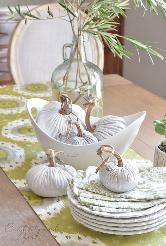 white linen pumpkins on table